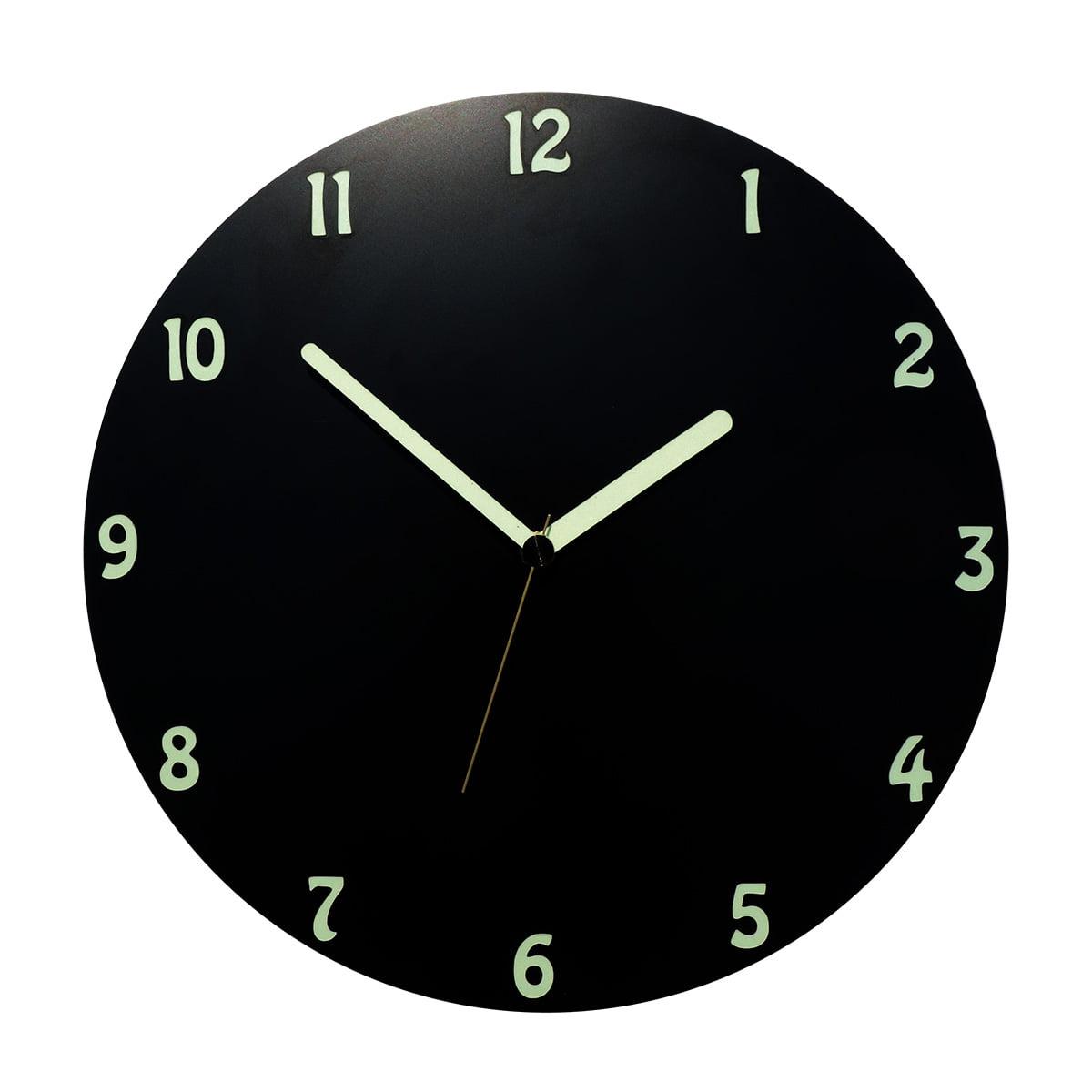 Un ceas negru rotund fosforescent ziua